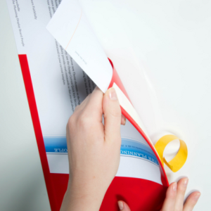 Document Display Pockets, adhesive backing application